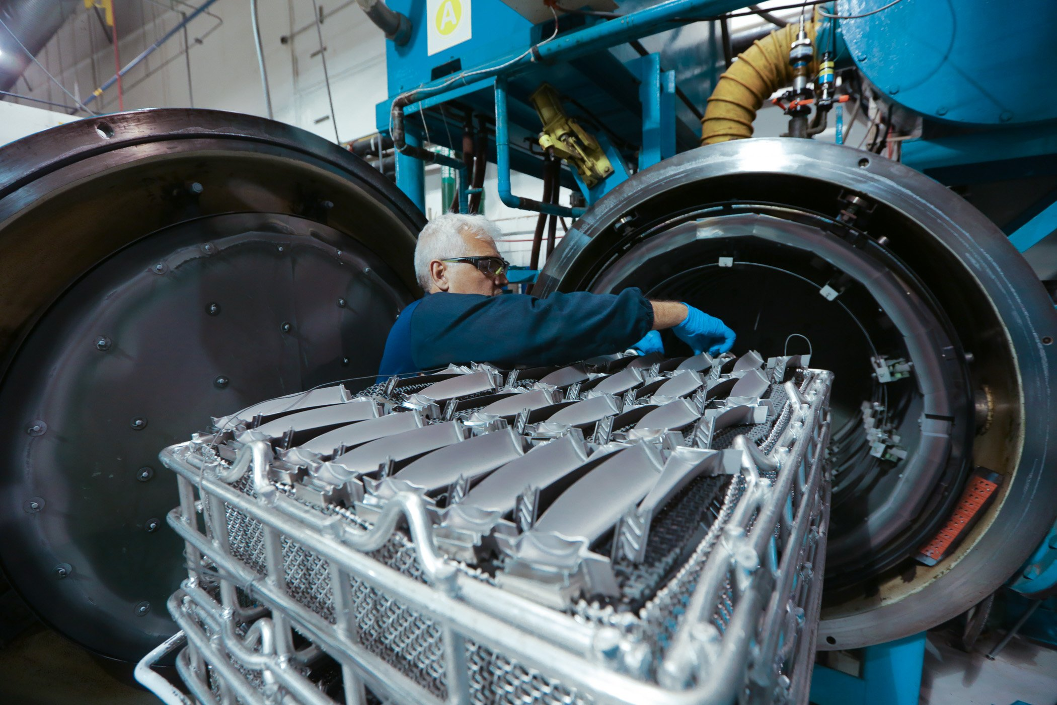 Factory Worker in Mexico making aerospace engine components