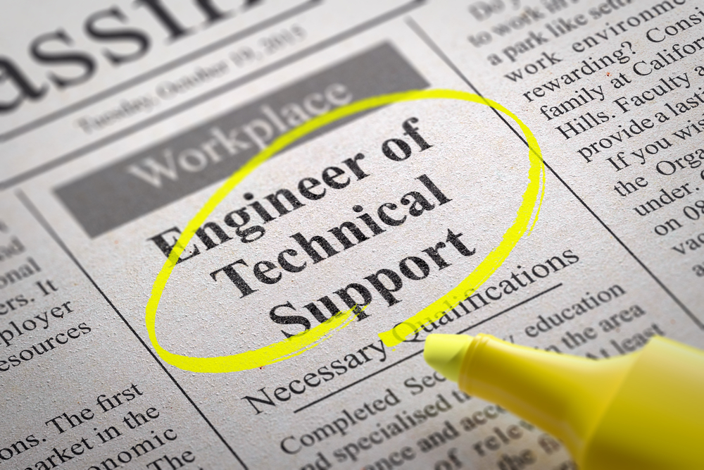 Engineer of Technical Support Vacancy in Newspaper. Job Seeking Concept.