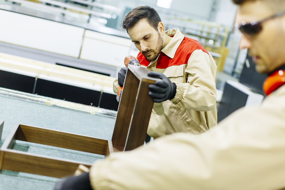 Employees working in a cabinet manufacturing facility in Mexico
